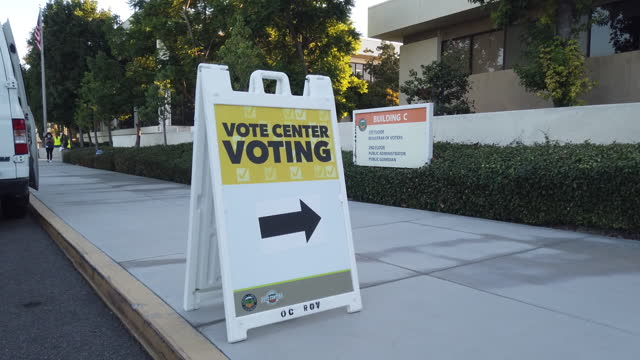 polling station directional sign on sidewalk, in santa ana, ca, u.s., on tuesday, september 14, 2021. californians are heading to the polls tuesday... - directional sign stock videos & royalty-free footage