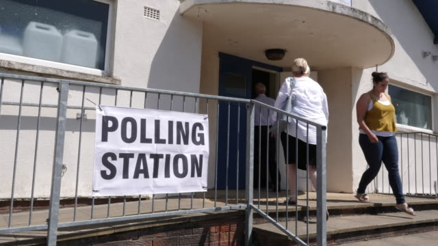 4k: polling station sign / banner outside voting place for elections - election stock videos and b-roll footage