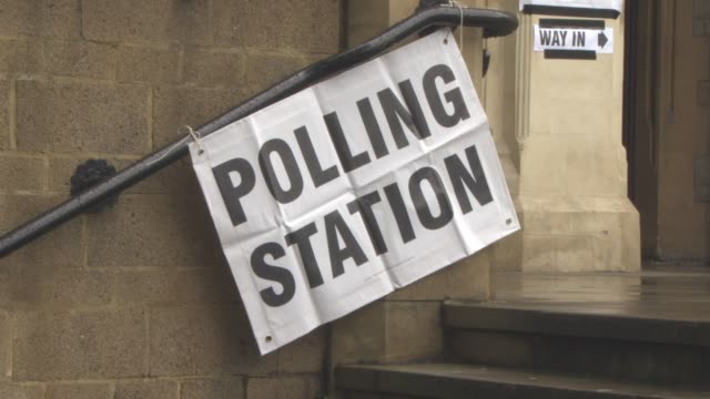 views polling station signage outside ealing town hall at the eu referendum the uk votes on june 23 2016 in london england - 国民投票点の映像素材/bロール