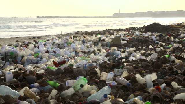 polluted beach with plastic bottles - plastic stock videos & royalty-free footage
