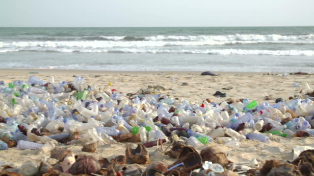 polluted beach with plastic bottles - garbage stock videos & royalty-free footage