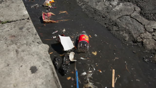 cu polluted gutter and street / roseau, dominica - gutter stock videos and b-roll footage
