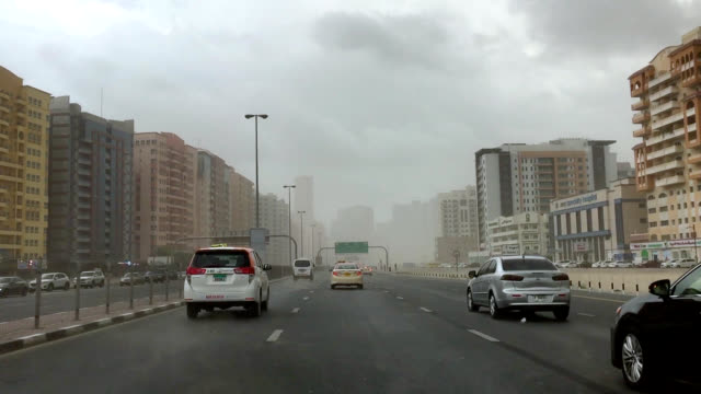 polluted street in residential area in dubai - air pollution stock videos & royalty-free footage