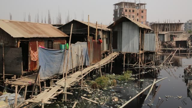polluted water from factories waste enter in the lake at slum area in dhaka bangladesh in recent report says slum dwellers at risk of diabetes and... - standing water stock videos & royalty-free footage