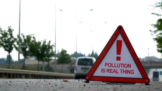 pollution is a real thing! - traffic sign - punctuation mark stock videos & royalty-free footage