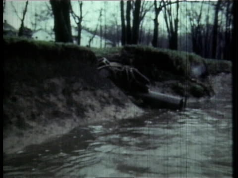 1966 pov pollution on the cuyahoga river / ohio, united states - fiume cuyahoga video stock e b–roll