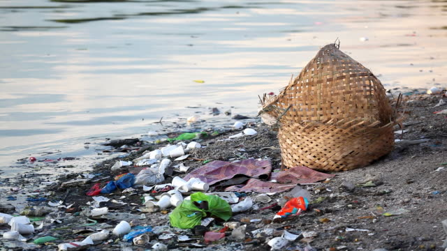 HD pollution - trash along riverbank