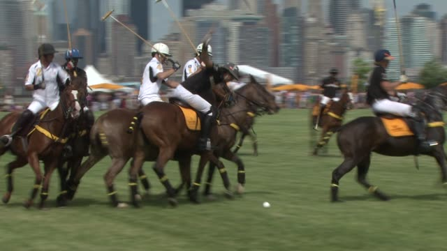 polo match at the fifth annual veuve clicquot polo classic at liberty state park on june 02 2012 in jersey city new jersey - 動物を使うスポーツ点の映像素材/bロール