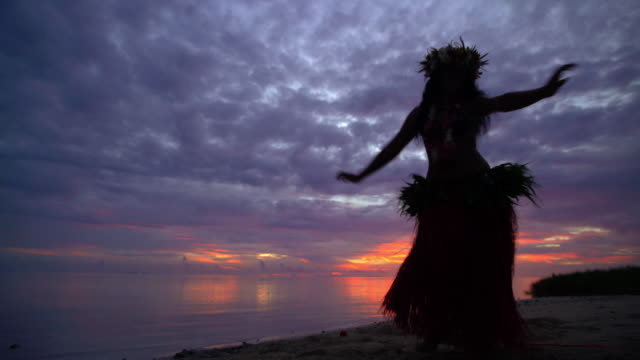 polynesian girl in grass skirt dancing on beach - headdress stock videos & royalty-free footage