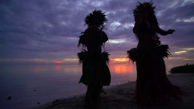 polynesian male and female dancer on sunset beach - tahitian culture stock videos & royalty-free footage