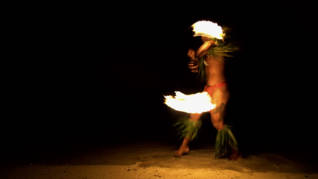 polynesian male dancer performing art of fire dancing - polynesian culture stock videos and b-roll footage