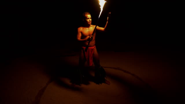 polynesian male dancer performing in ring of fire - tahitian culture stock videos & royalty-free footage