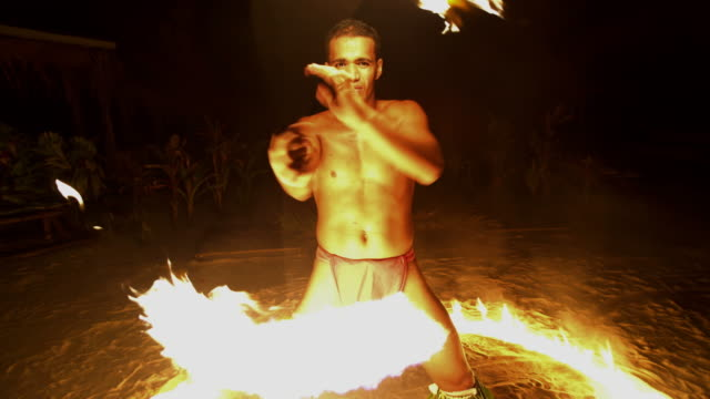 polynesian male dancer performing in ring of fire - polynesian ethnicity stock videos & royalty-free footage
