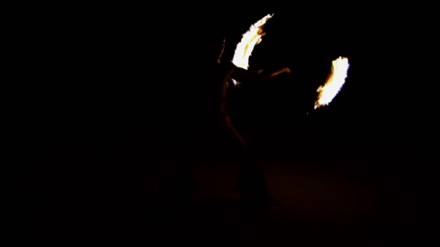 polynesian male fire dancer performing with flaming torch - polynesian culture stock videos & royalty-free footage