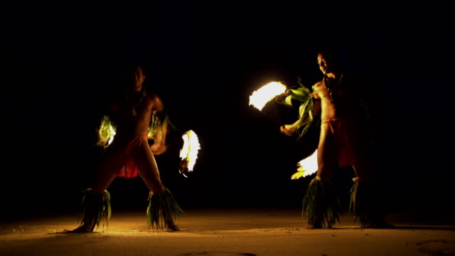 polynesian male fire dancers performing with flaming torches - polynesian culture stock videos and b-roll footage
