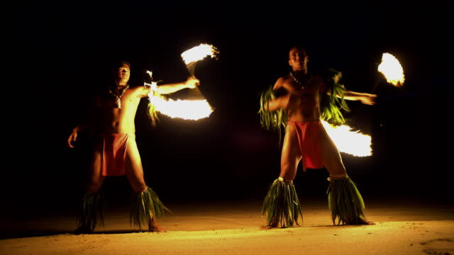 polynesian male fire dancers performing with spinning torches - polynesian culture stock videos & royalty-free footage