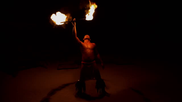 polynesian male fire eater performing with flaming torches - polynesian culture stock videos and b-roll footage
