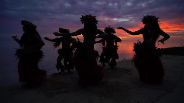 polynesian males and female dancers on sunset beach - polynesian culture stock videos & royalty-free footage