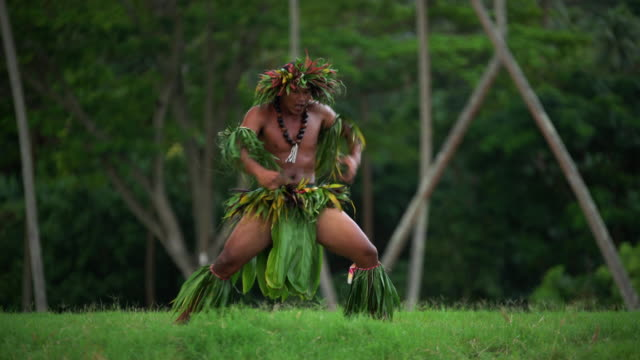 polynesian man in traditional costume dancing barefoot outdoors - tahitian culture stock videos & royalty-free footage