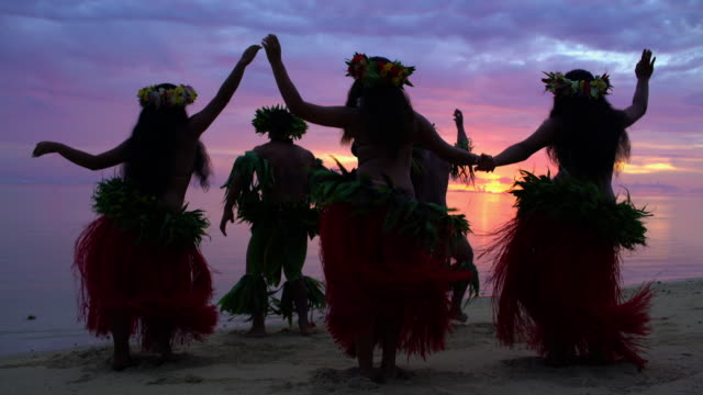 polynesian men entertaining in warrior dress at sunset - polynesian ethnicity stock videos & royalty-free footage