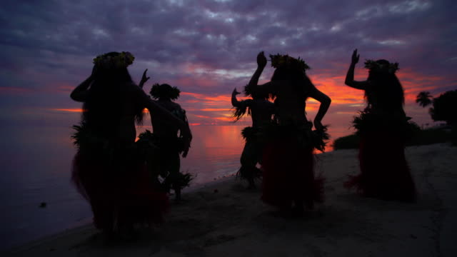 polynesian men entertaining in warrior dress at sunset - headdress stock videos & royalty-free footage