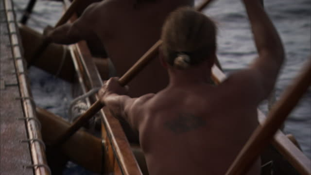 polynesian men row a canoe. - polynesian ethnicity stock videos & royalty-free footage