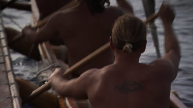 polynesian men row a canoe. - polynesian ethnicity stock videos & royalty-free footage