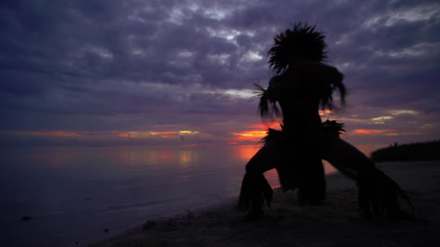 polynesian sunset young man dancing in traditional costume - headdress stock videos & royalty-free footage