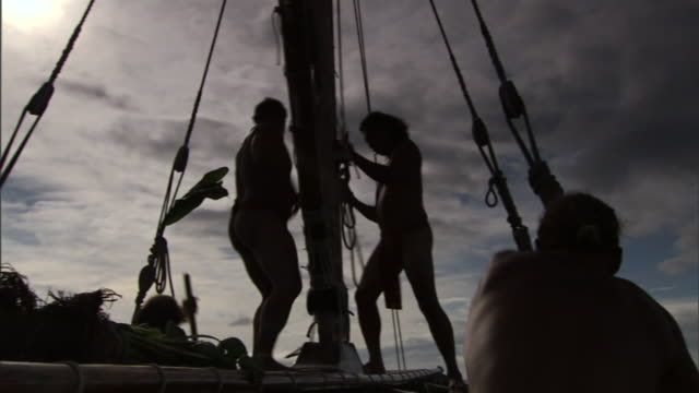 polynesians adjust rigging on a longboat as they journey to hawaii. - polynesian ethnicity stock videos & royalty-free footage