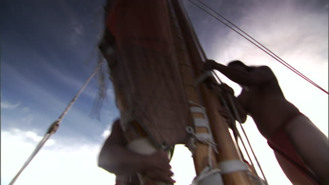 polynesians adjust the rigging of their boat as they journey to hawaii. - polynesian ethnicity stock videos & royalty-free footage