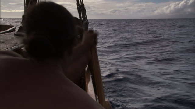 polynesians in a canoe emigrate across the pacific ocean to hawaii. - polynesian ethnicity stock videos & royalty-free footage