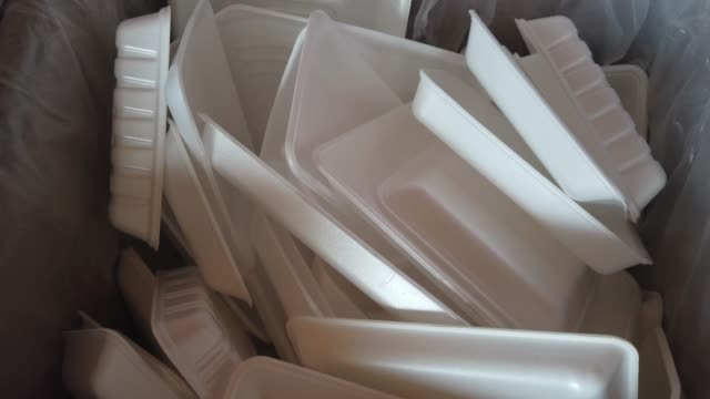 polystyrene trays are collected together at kamikatsu waste recycling facility on july 2, 2020 in kamikatsu, japan. kamikatsu is a zero waste town... - ポリスチレン点の映像素材/bロール
