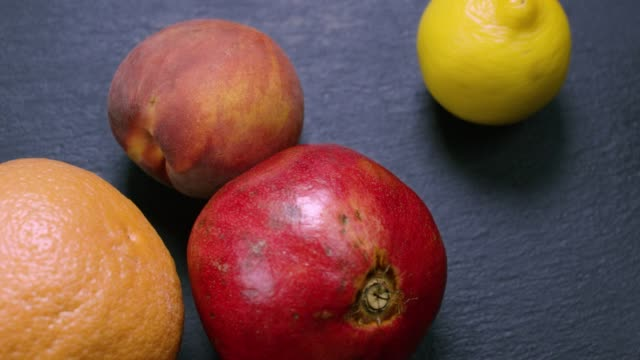 pomegranate, peach, orange and spinning lemon - antioxidant stock videos & royalty-free footage
