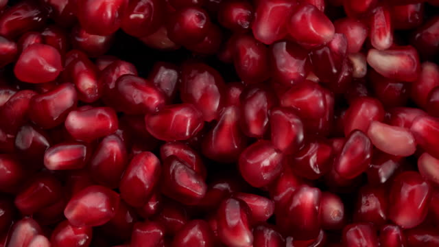 pomegranates in the air on black background - antioxidant stock videos & royalty-free footage