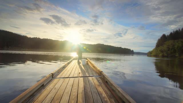 Pond and dock reflecting sky, Oregon