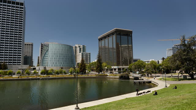 pond and lawn outside marqeta inc. headquarters in oakland, california, u.s., on wednesday, may 19, 2021. digital payments firm marqeta inc. filed... - electronic banking stock videos & royalty-free footage