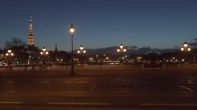 pont alexandre iii and the eiffel tower illuminated during the 6pm curfew, to help stop the spread of the coronavirus , on march 11, 2021 in paris,... - 6 11 months stock videos & royalty-free footage