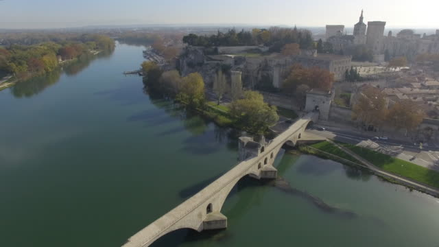 pont d'avignon bridge and historic centre of avignon, france – aerial view by drone - rhone river stock videos & royalty-free footage