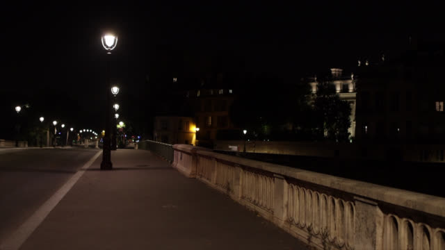 pont de sully without people at the start of the new curfew in paris, france. curfew from 9 p.m. to 6 a.m. in nine metropolises, announced by the... - electric lamp stock videos & royalty-free footage