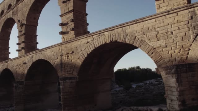 pont du gard in golden sunrise - aqueduct stock videos and b-roll footage