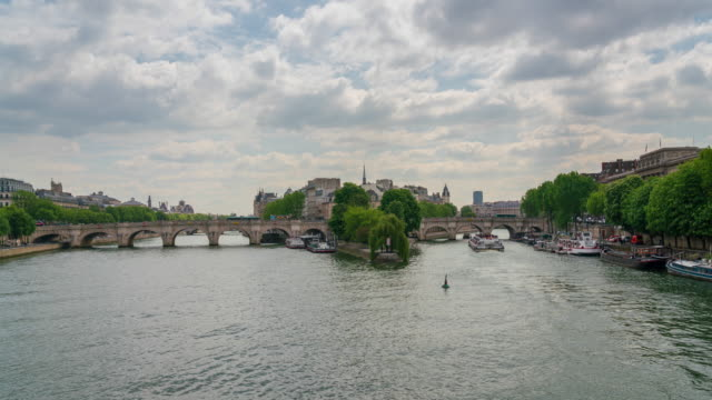 pont neuf over the river seine in paris 4k time lapse - river seine stock videos & royalty-free footage