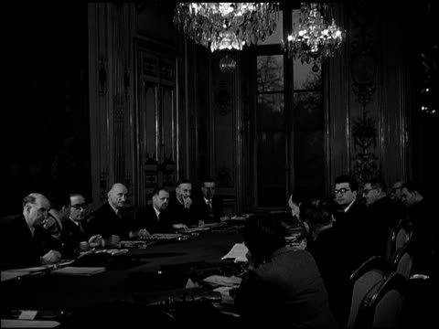vídeos de stock e filmes b-roll de pont notredam over seine river prime minister robert schuman at conference table w/ new cabinet members minister of finance rene mayer next to him... - 1947