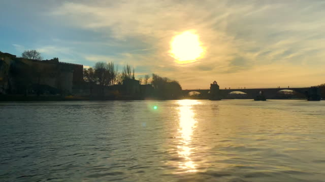 pont sant benezet and palais des papes over rhone river in sunset in avignon - rhone river stock videos & royalty-free footage