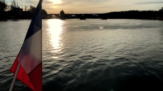 pont sant benezet over rhone river and french flag in sunset in avignon - rhone alpes stock videos & royalty-free footage