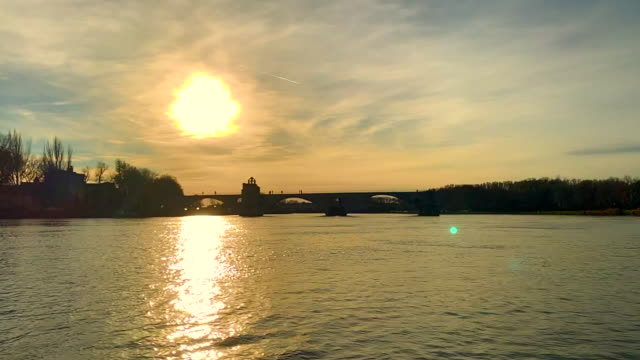 pont sant benezet over rhone river in sunset in avignon - rhone river stock videos & royalty-free footage