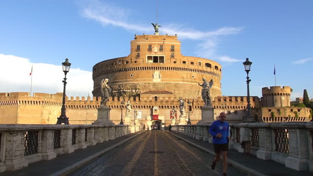 ws ponte sant angelo sculptures leading to sant angelo castle and people walking / rome, latium, italy - ponte stock videos & royalty-free footage
