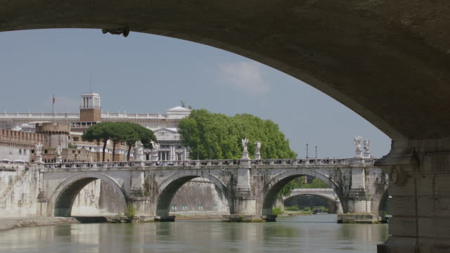 ms ponte sant'angelo and hadrian's tomb over tiber river - arch bridge stock videos and b-roll footage