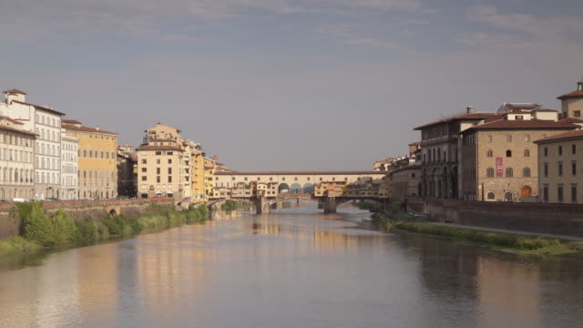 ponte vecchio and the river arno, florence, italy. - ponte stock videos & royalty-free footage