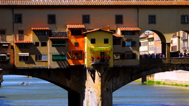 ponte vecchio bridge and arno river in florence, italy - mediterranean culture stock videos & royalty-free footage