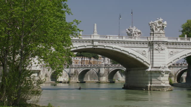 ws ponte vittorio emanuele ii, man rowing in river / rome, italy - ponte stock videos & royalty-free footage